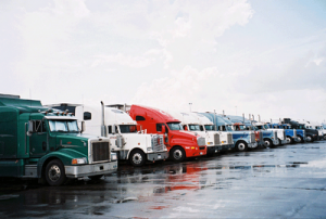 learn currency trading - a row of trucks